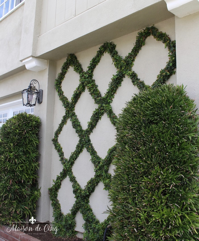 diamond pattern espalier trellis on wall of front of house