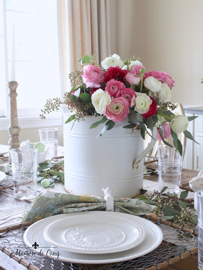 spring table with ranunculus and bunny plates gorgeous Easter tablescape