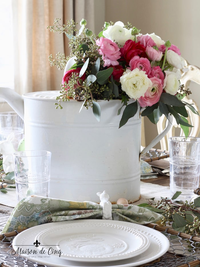 centerpiece with ranunculus and eucalyptus in vintage white enamel watering can charming French vintage style