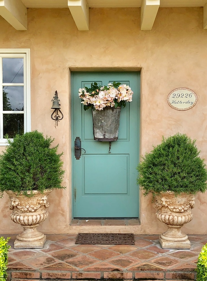 outdoor decorating ideas porch with blue door and pots