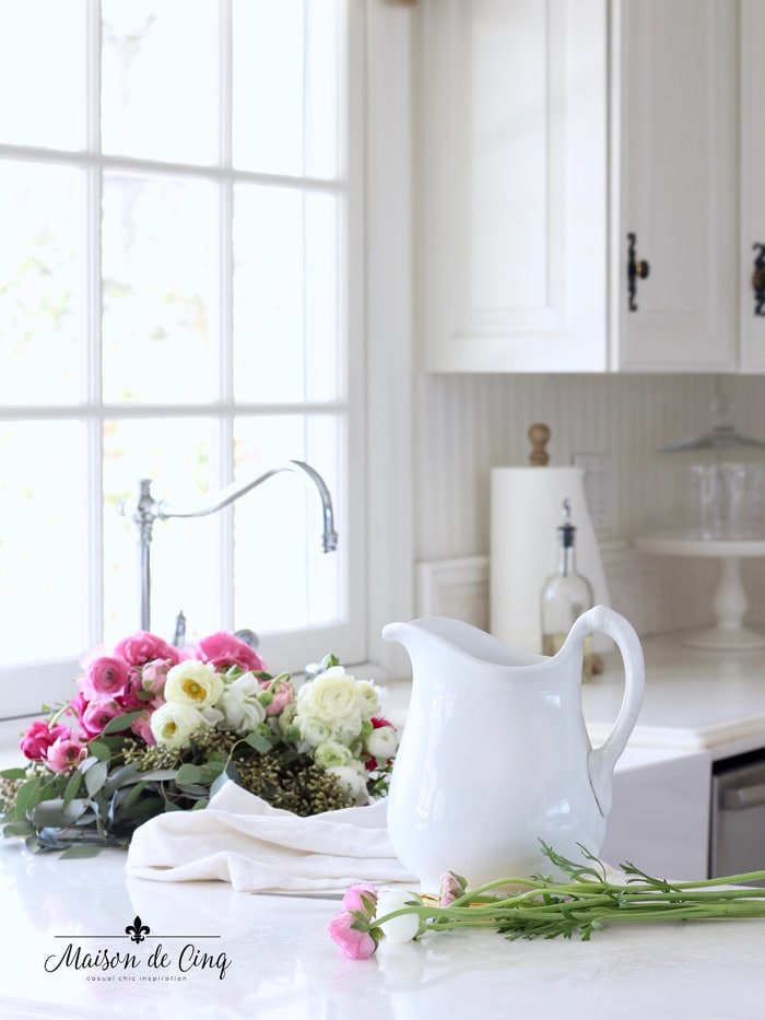 flowers in sink beautiful pink ranunculus in white farmhouse kitchen