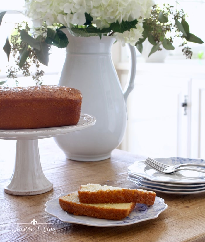 pound cake on pedestal plate with flowers and plates dessert serving ideas