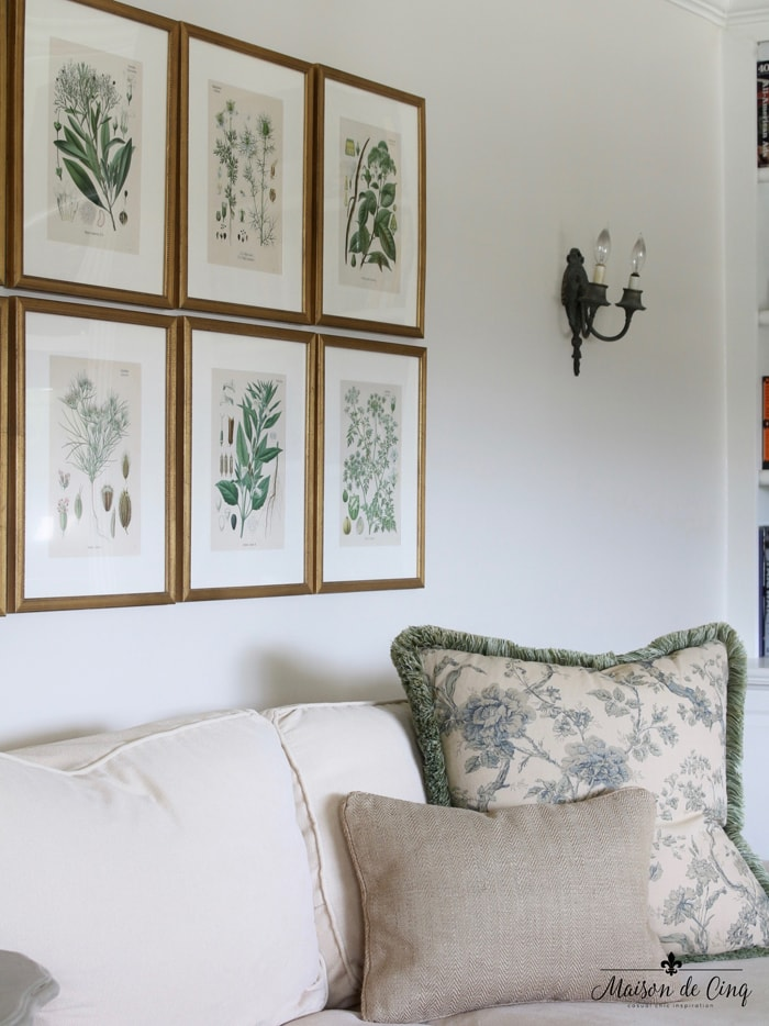 decorating with art vintage botanicals in family room French country