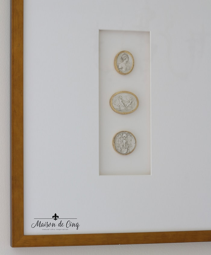 framed intaglios matted in white in gold frame