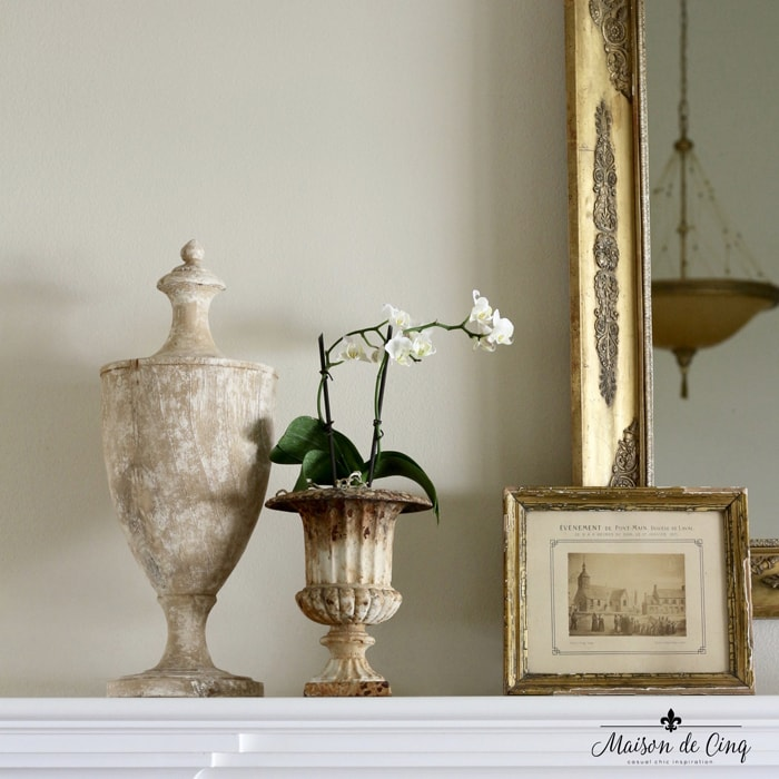 how to decorate with art vintage gold framed print leaning on mantel French country room