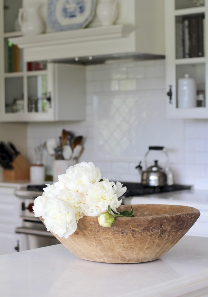 antique French dough bowls in gorgeous white French farmhouse kitchen