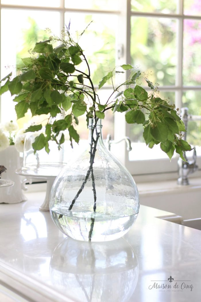 antique French demijohn in white farmhouse kitchen