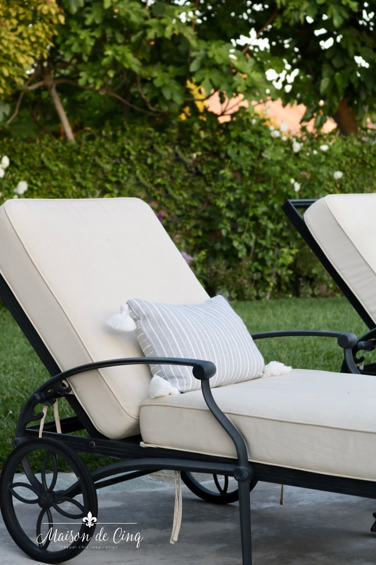 grey stripe pillows on black iron chaise lounges backyard refresh