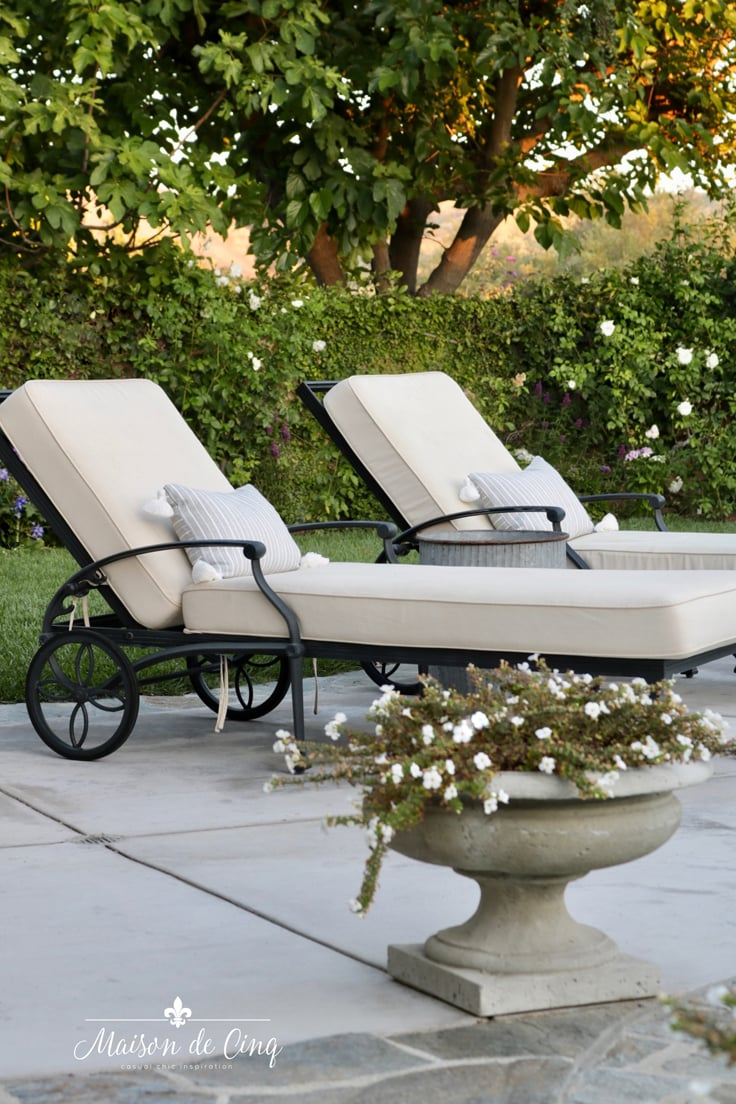 chaise lounges with grey stripe pillows French country backyard patio decor