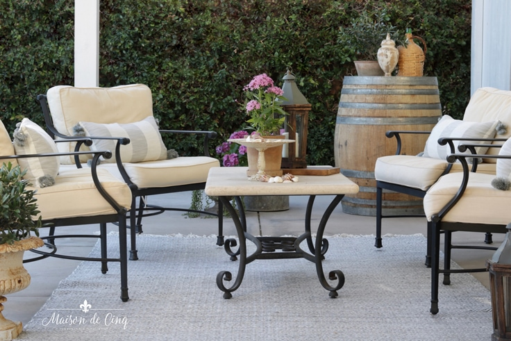 gorgeous French country outdoor patio refresh with black iron furniture plants and flowers