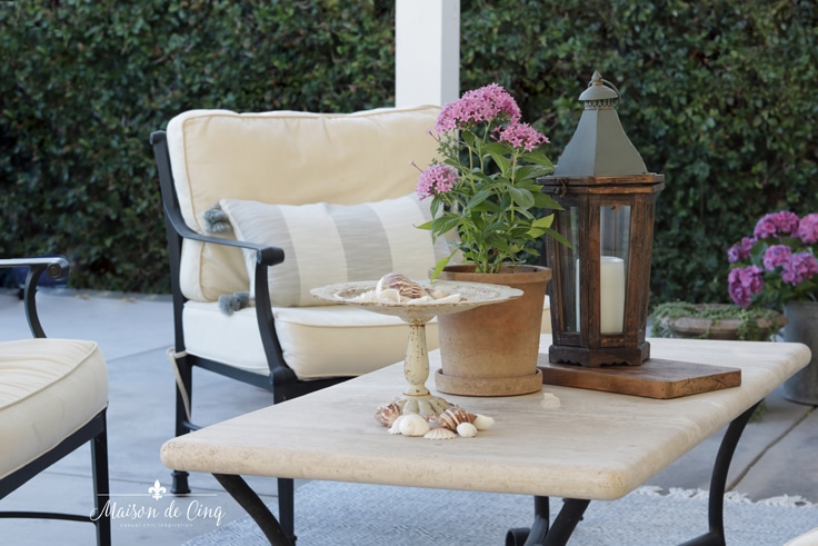 outdoor patio refresh with new pillows and potted flowers lantern French country style