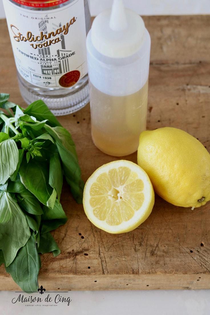 lemon basil syrup lemons and basil on board