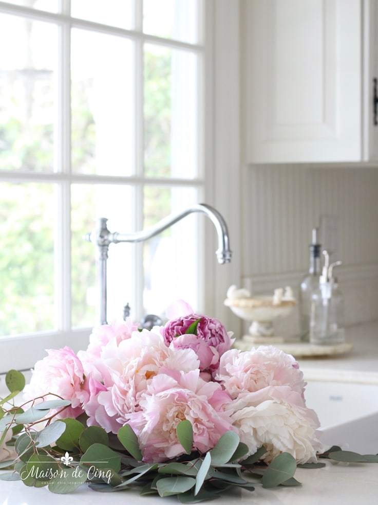 pink peonies in gorgeous white kitchen