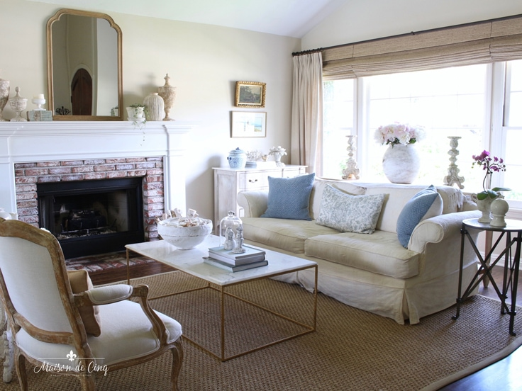 blue pillows add simple summer decor in French farmhouse living room