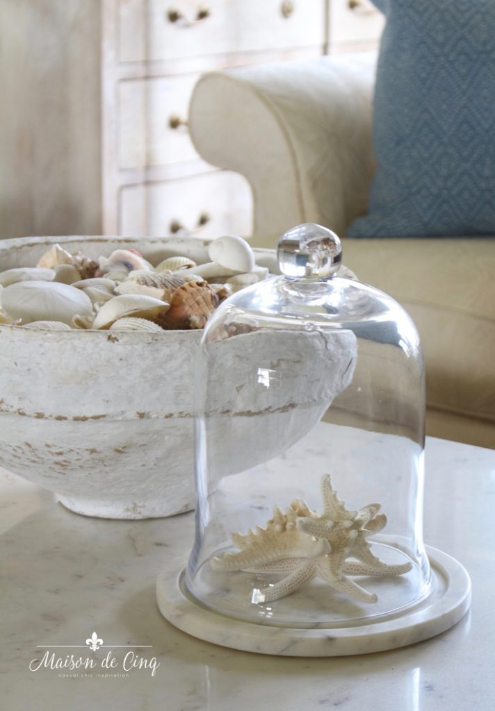 how to decorate for summer shells and starfish in glass cloche