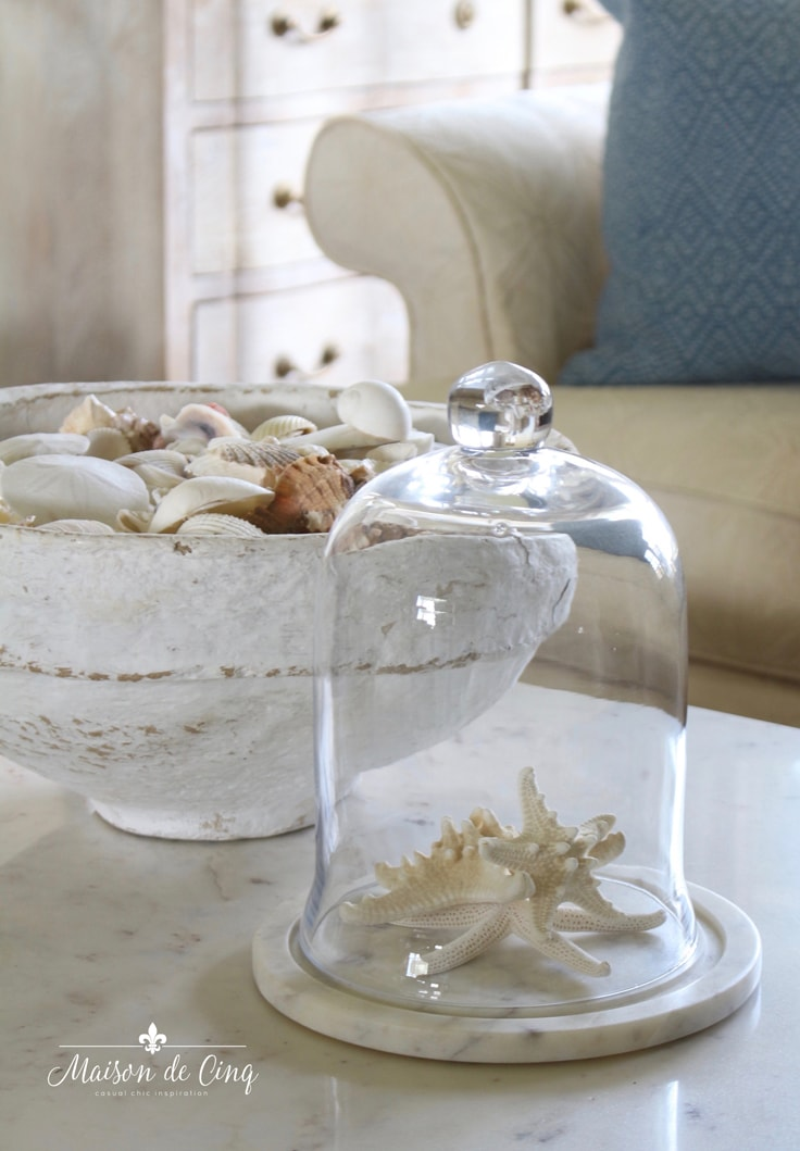 shells in bowl and starfish under glass cloche simple summer decorating idea