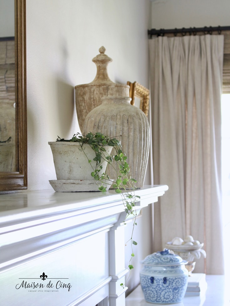 plant on mantel with urns French farmhouse summer living room