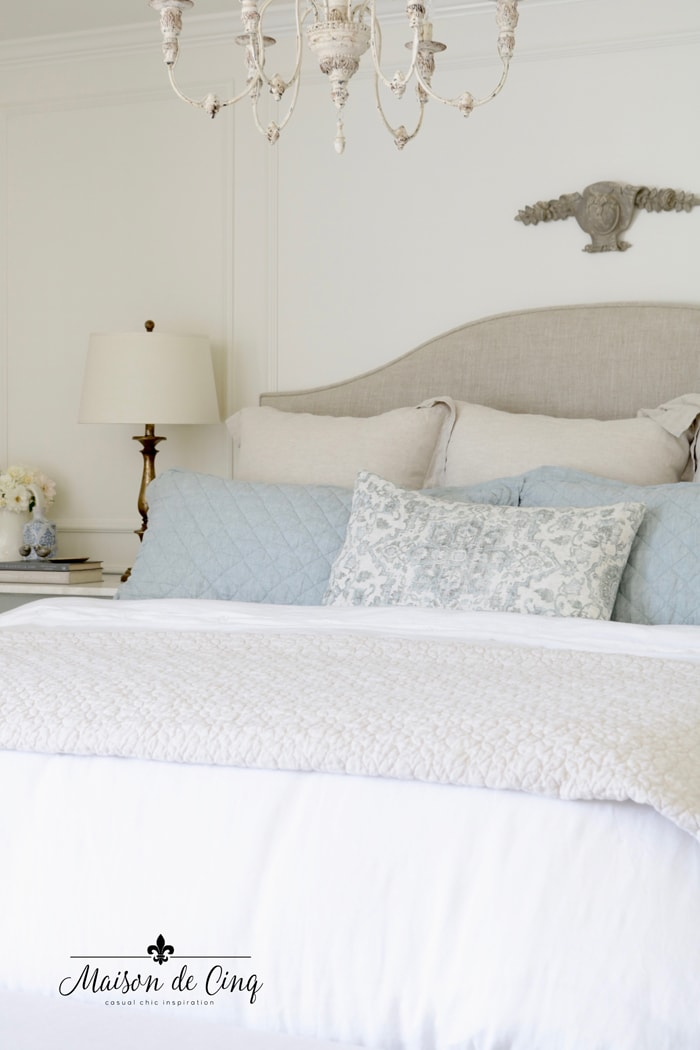 favorite bedding formula blue and neutral linen pillows in pretty French farmhouse bedroom