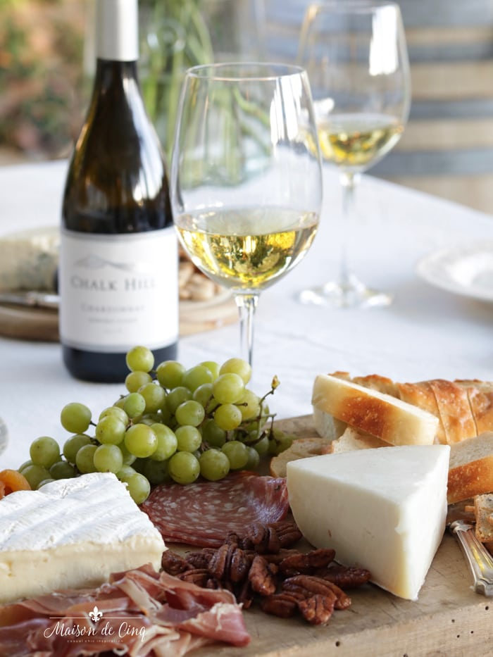 delicious meats cheeses fruits on platter with white wine summer entertaining outdoors