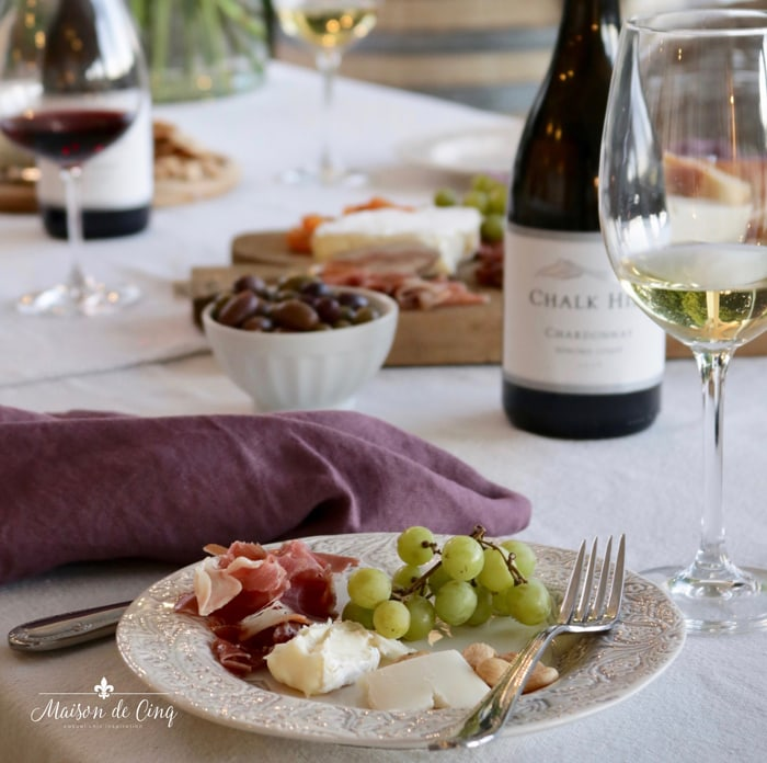 meats and cheeses on plate and white wine summer entertaining