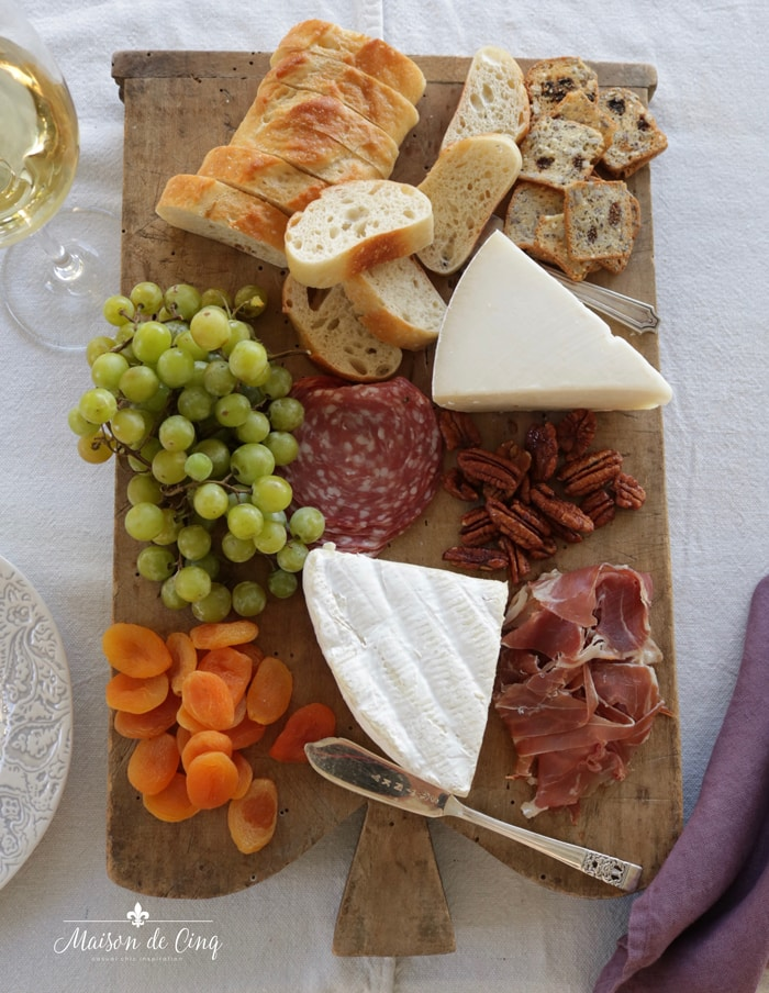 charcuterie platter with gourmet cheeses meats breads nuts