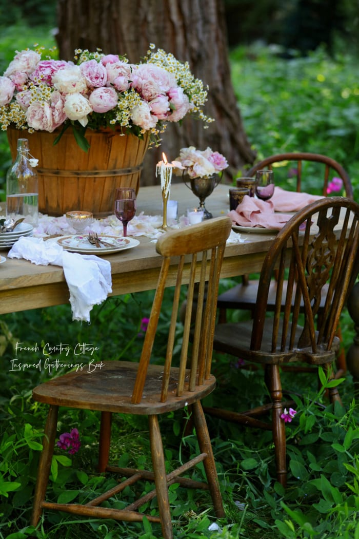gorgeous table setting in woods with peonies