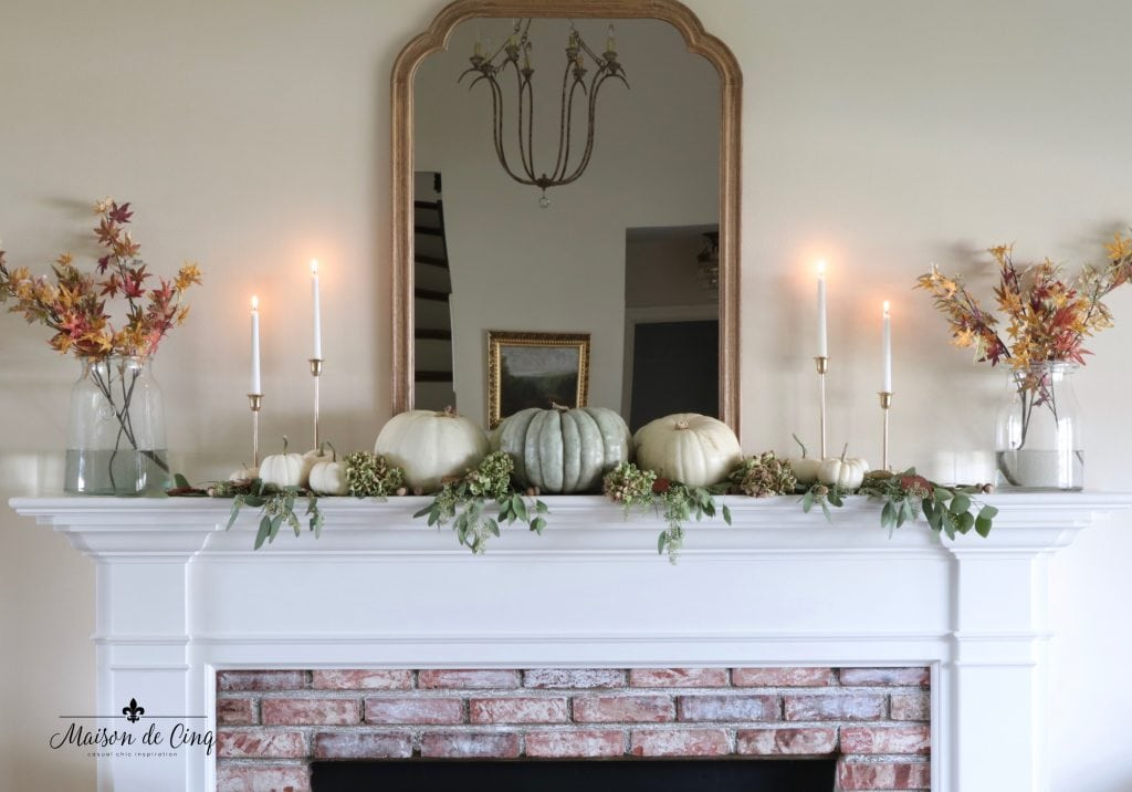 fall mantel decor idea leaves muted pumpkins brass candlesticks