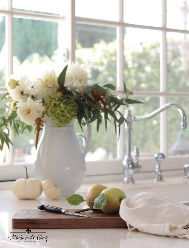 fall flowers in vase on counter in white farmhouse kitchen fall decor white pumpkins