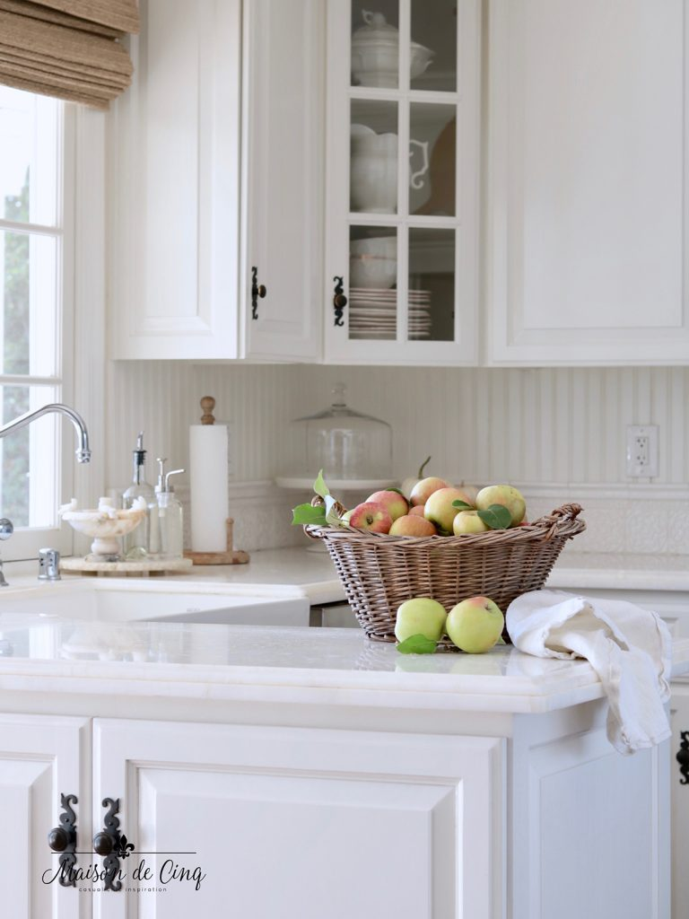 white farmhouse kitchen with autumn decor ideas apples in vintage basket