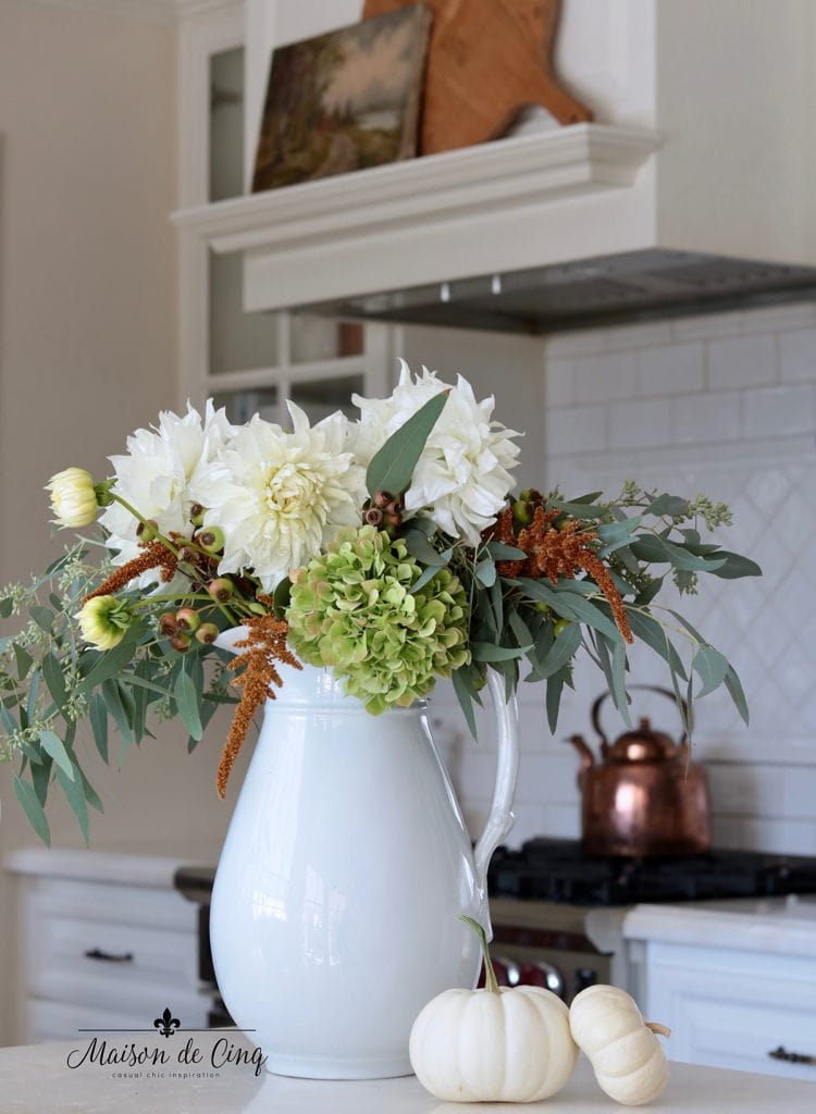 gorgeous fall flowers with white pumpkins in French farmhouse kitchen