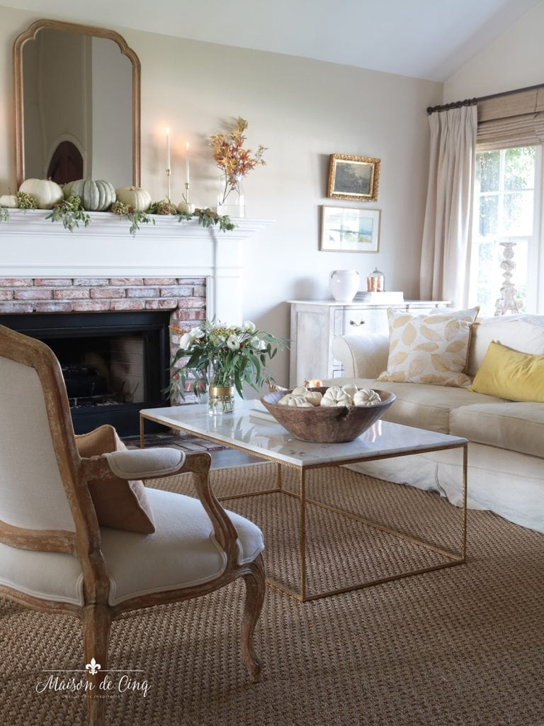 fall living room decorating ideas mustard yellow pillows flowers and pumpkins French country style
