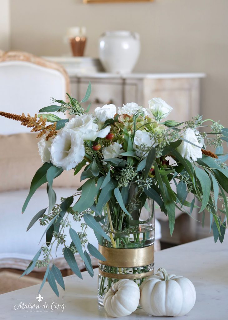 gorgeous fall floral arrangement in glass vase with white pumpkins fall decorating ideas