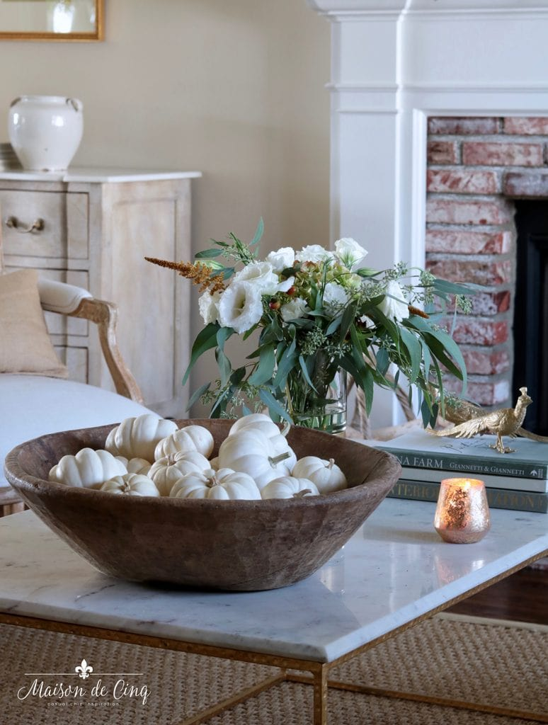 fall coffee table decor white baby boo pumpkins in dough bowl and flowers in glass vase