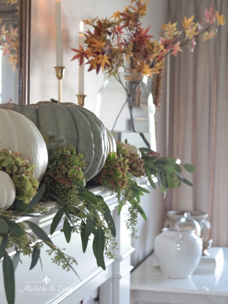 green and white pumpkins with hydrangeas and eucalyptus gorgeous autumn decor