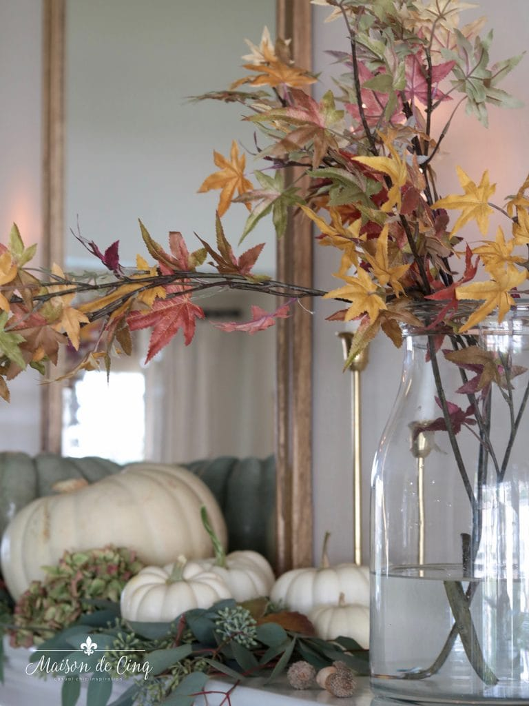 fall leaves in vase and white pumpkins on mantel decorating ideas
