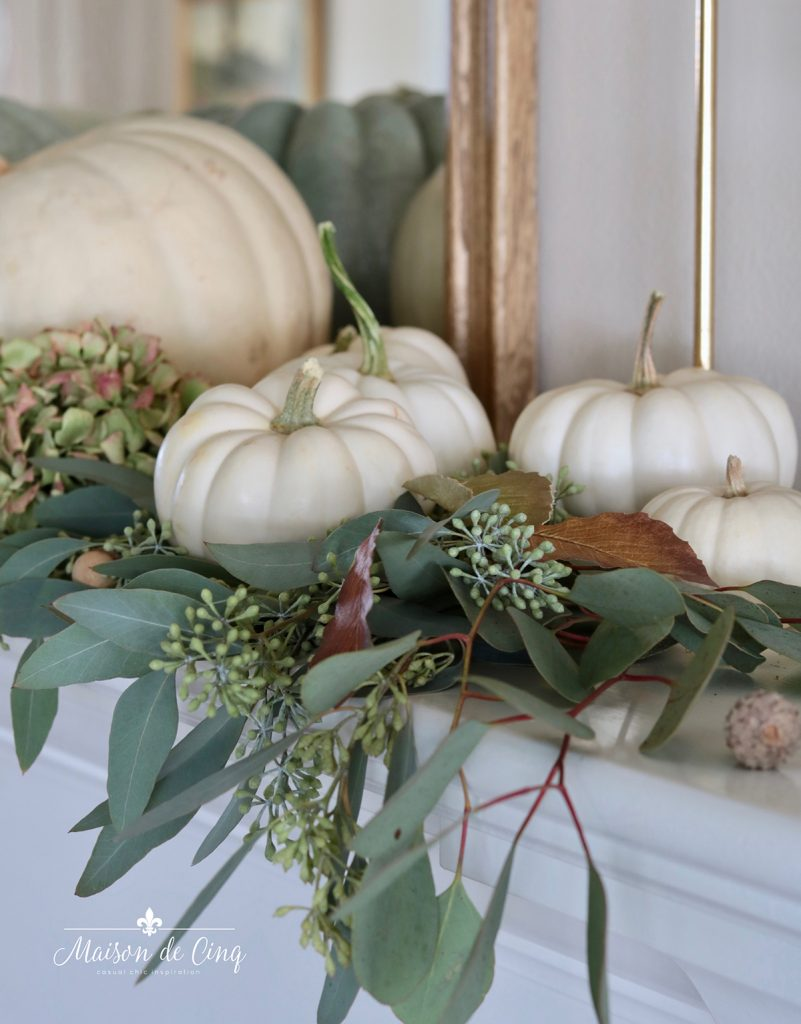 white pumpkins on fall mantel with eucalyptus gorgeous fall decor