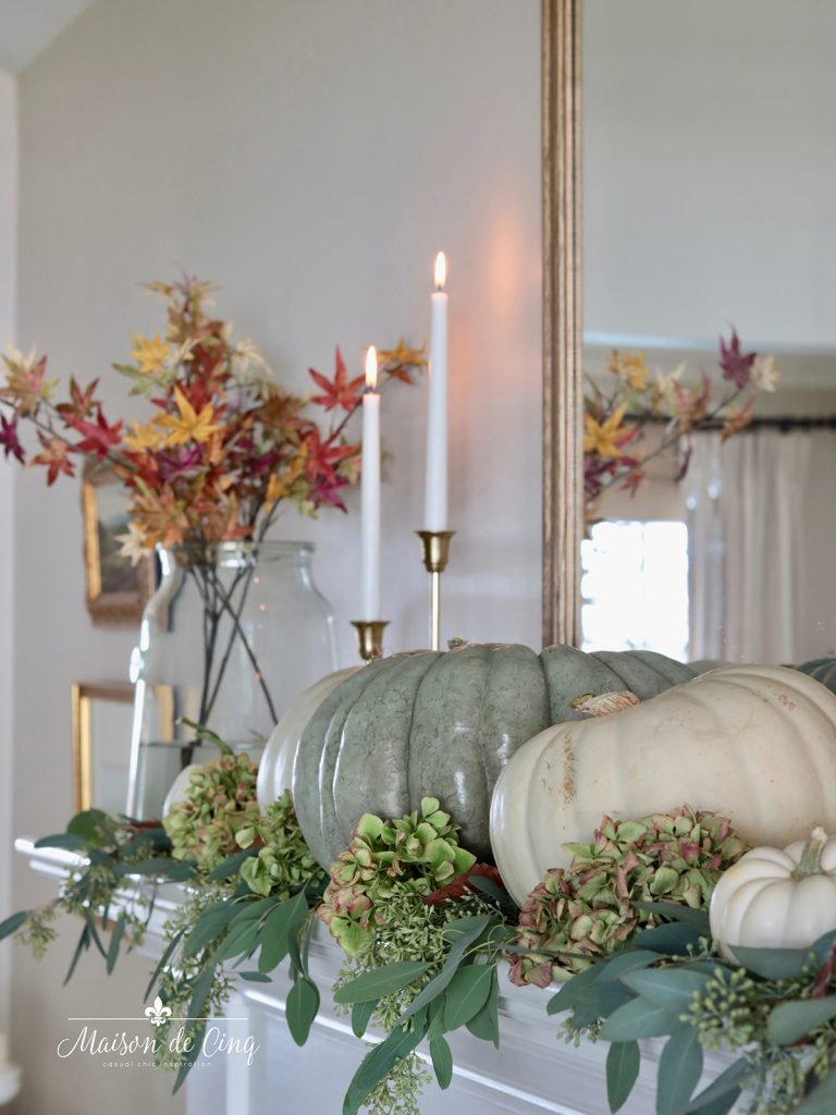 gorgeous fall mantel turning leaves and green and white pumpkins