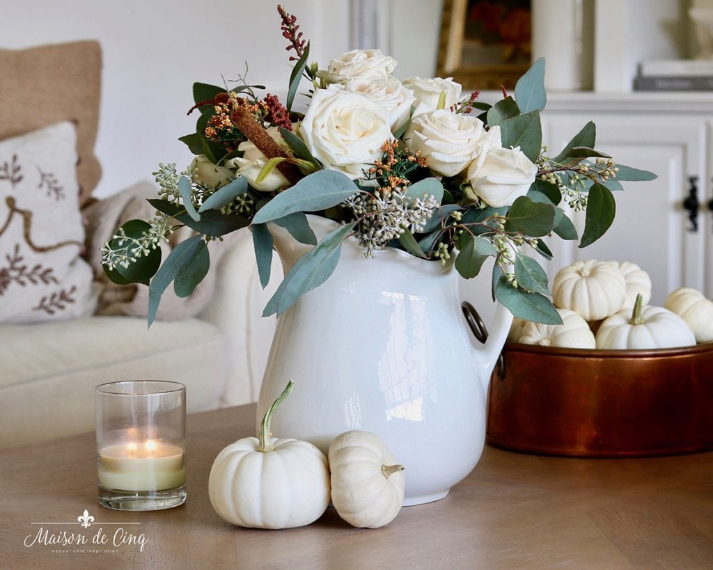 white flowers with eucalyptus and cattails fall flowers pumpkins