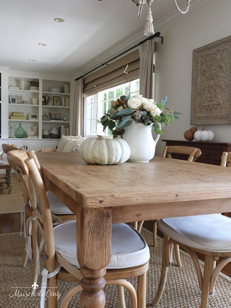 farmhouse table with flowers and pumpkin simple fall decor ideas