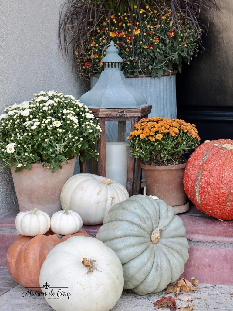heirloom pumpkins and lanterns on fall porch decorating idea