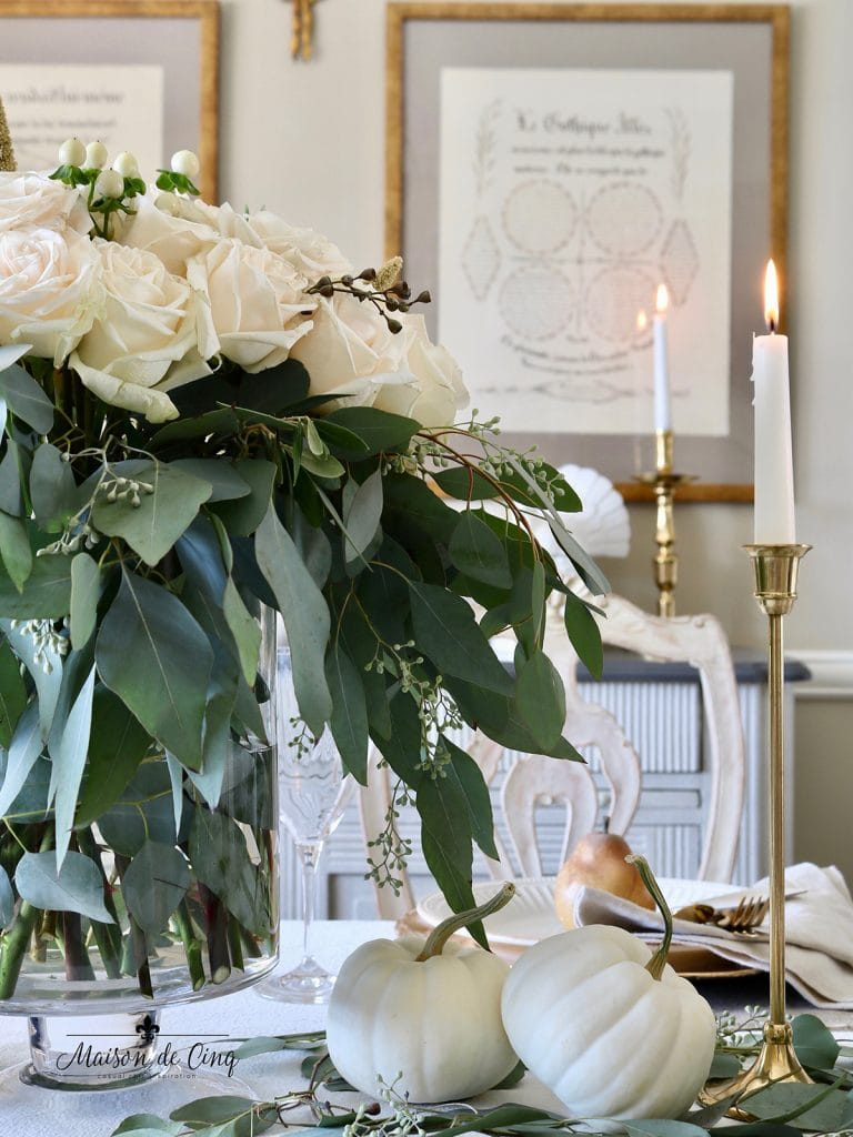 gorgeous neutral thanksgiving table in French country dining room brass candlesticks and white pumpkins