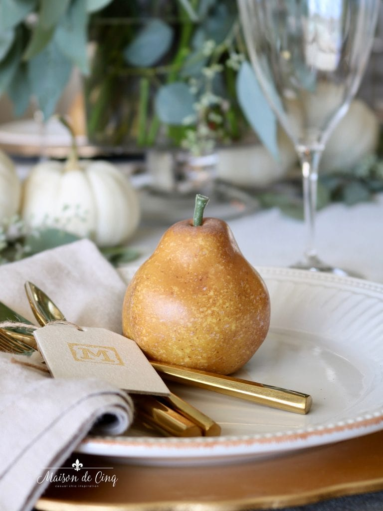 pretty fall table setting with linen napkins and gold flatware on white plate