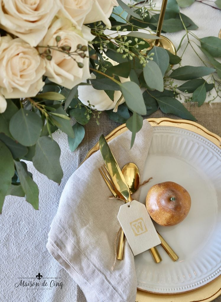 beautiful neutral Thanksgiving table setting idea roses eucalyptus and pears