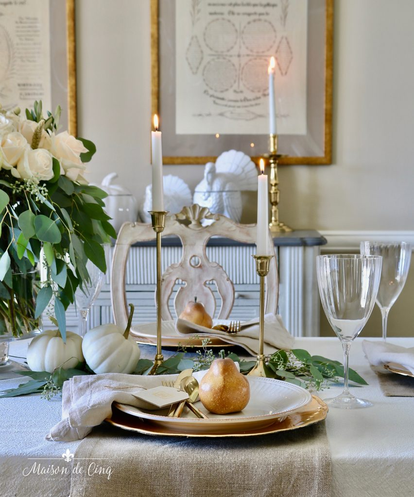 neutral Thanksgiving table setting idea pears roses and brass candlesticks