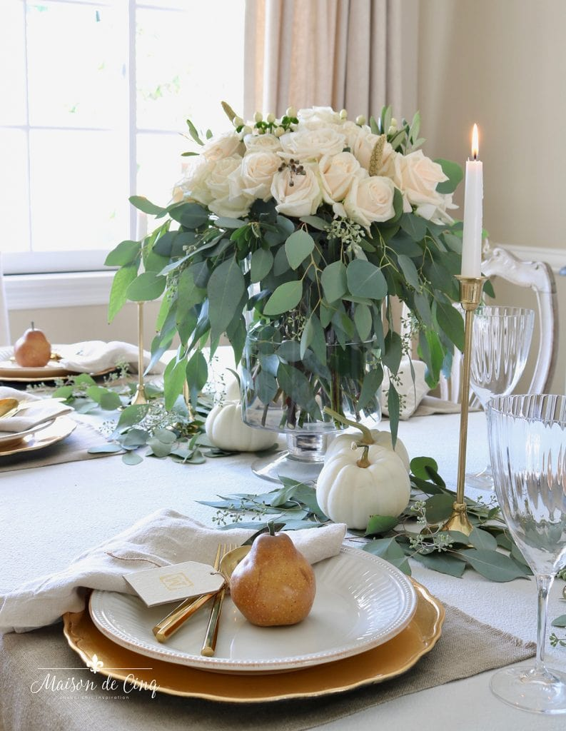white roses and pears with white plates and white pumpkins fall table