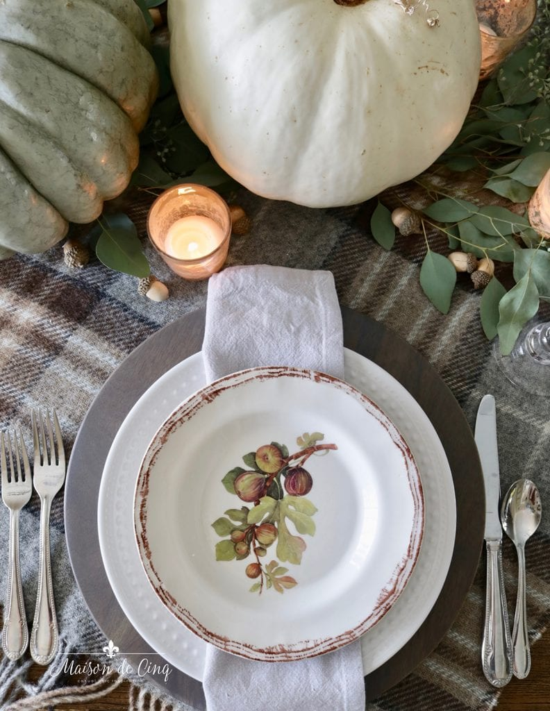 fig plates with wood chargers pumpkins and eucalyptus pretty fall table setting