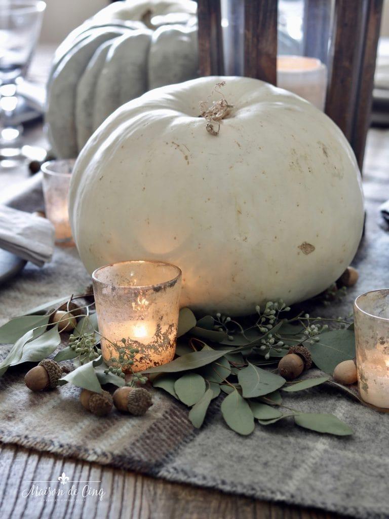 white pumpkins mercury glass votive and eucalyptus easy fall table setting ideas