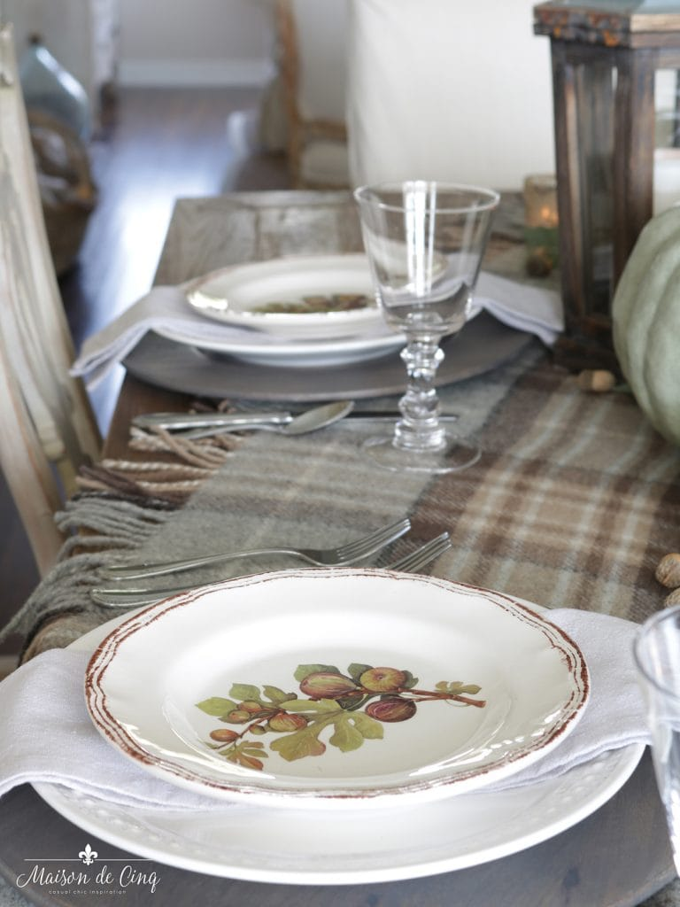 fall table setting with plaid and pumpkins green and brown