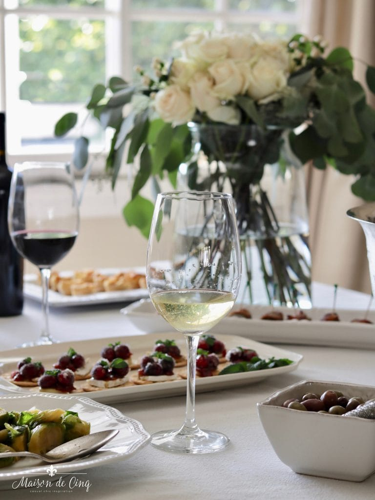 easy elegant wine and appetizer holiday party gathering white roses platters of food