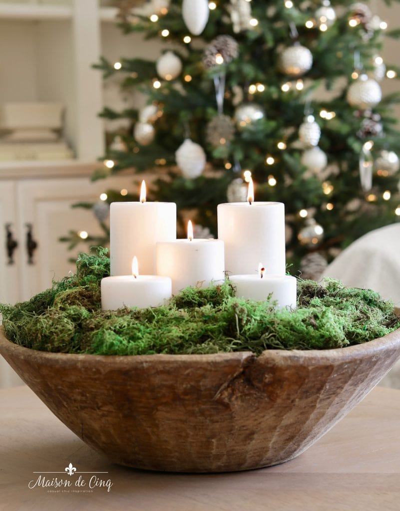 gorgeous dough bowl with moss and candles christmas decorating idea